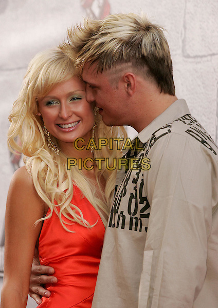 PARIS HILTON & NICK CARTER .at the 2004 MTV Movie Awards held at The Sony Picture Studios in Culver City, .California,.June 6th 2004.half length half-length boyfriend girlfriend long orange dress kissing hugging.*UK sales only*.www.capitalpictures.com.sales@capitalpictures.com.©Capital Pictures