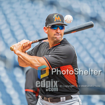 14 May 2016: Miami Marlins bullpen coordinator Jeff Urgelles taps out grounders prior to the first game of a double-header against the Washington Nationals at Nationals Park in Washington, DC. The Nationals defeated the Marlins 6-4 in the afternoon matchup.  Mandatory Credit: Ed Wolfstein Photo *** RAW (NEF) Image File Available ***