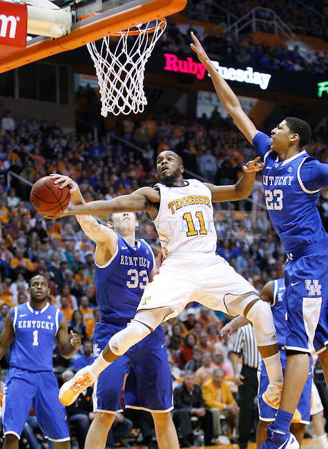 UK freshmen Kyle Wiltjer and Anthony Davis apply heavy pressure to Tennessee's Trae Golden during the first half of UK's game against Tennessee at Thompson-Boling Arena in Knoxville, Tenn., Jan. 14, 2012.Photo by Brandon Goodwin | Staff