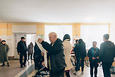 People check the voting sheet at one of the polling stations in Lutsk. It has a record length in Ukrainian history with 34 candidates. It was 81 cm long.