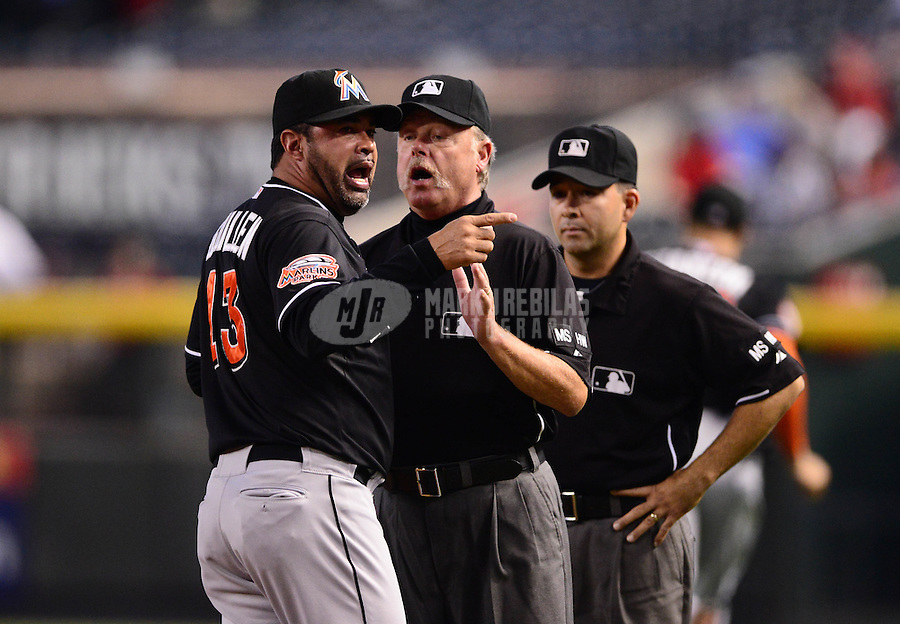 Aug. 22, 2012; Phoenix, AZ, USA: Miami Marlins manager Ozzie Guillen (left) is held back by umpire Jim Joyce as he argues with umpire Angel Campos after being ejected in the third inning against the Arizona Diamondbacks at Chase Field. Mandatory Credit: Mark J. Rebilas-