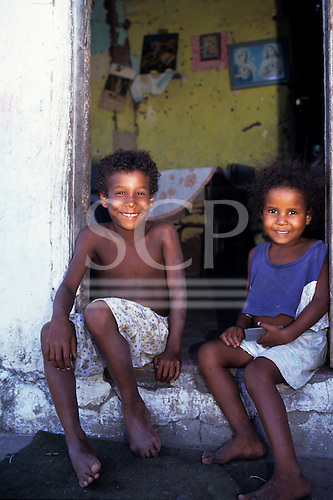 Cachoeira, Brazil. Boy and girl sitting in the doorway of their poor house. Bahia State.