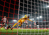 24th November 2019; Bramall Lane, Sheffield, Yorkshire, England; English Premier League Football, Sheffield United versus Manchester United; Mason Greenwood of Manchester United scores in the 77th minute to make it 2-2 beating Simon Moore of Sheffield United with Phil Jagielka of Sheffield United close by - Strictly Editorial Use Only. No use with unauthorized audio, video, data, fixture lists, club/league logos or 'live' services. Online in-match use limited to 120 images, no video emulation. No use in betting, games or single club/league/player publications