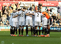 Pictured: Swansea players huddle before kick off. 01 February 2014<br /> Re: Barclay's Premier League, West Ham United v Swansea City FC at Boleyn Ground, London.