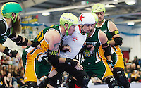 15 MAR 2014 - BIRMINGHAM, GBR - Team England jammer Rex Tangle (in white and red) forces his way through Wizards of Aus blockers during the inaugural Men's Roller Derby World Cup at the Futsal Arena in Birmingham, West Midlands, Great Britain (PHOTO COPYRIGHT © 2014 NIGEL FARROW, ALL RIGHTS RESERVED)