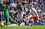 Steven Naismith scores no 4 for Rangers as he beats defender Jackie McNamara and slots home past Robert Olenjik