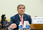 """United States Secretary of State John Kerry testifies before the U.S. House Committee on Foreign Affairs about the President's recently announced strategy on ISIS in Washington, D.C. on Thursday, September 18, 2014.  The hearing is entitled """"The ISIS Threat:  Weighing the Obama Administration's Response."""" <br /> Credit: Ron Sachs / CNP"""