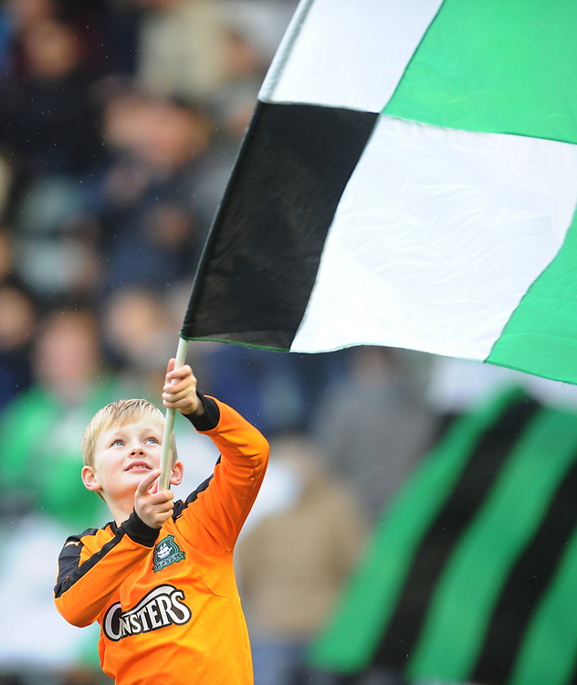 A young Plymouth Argyle fan waves a flag before kickoff<br /> <br /> Photographer Kevin Barnes/CameraSport<br /> <br /> The EFL Sky Bet League One - Plymouth Argyle v Fleetwood Town - Saturday 24th November 2018 - Home Park - Plymouth<br /> <br /> World Copyright © 2018 CameraSport. All rights reserved. 43 Linden Ave. Countesthorpe. Leicester. England. LE8 5PG - Tel: +44 (0) 116 277 4147 - admin@camerasport.com - www.camerasport.com