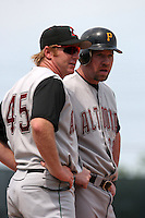 Altoona Curve manager Tim Leiper #45 talks with Sean Casey #29 during an Eastern League game at Jerry Uht Park on May 28, 2006 in Erie, Pennsylvania.  (Mike Janes/Four Seam Images)