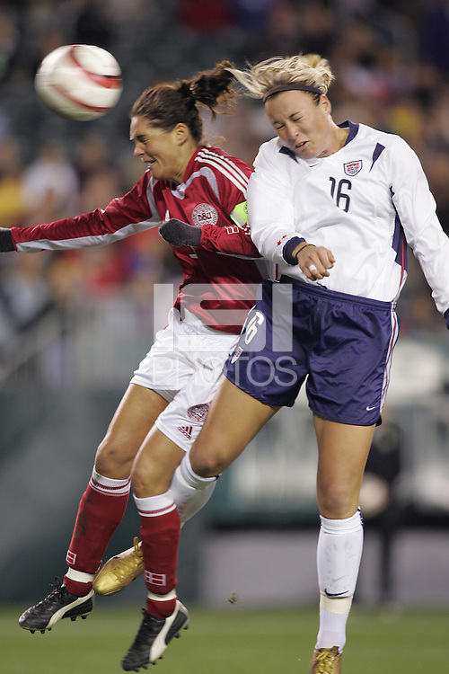 06 November,  2004.  USWNT forward Abby Wambach (16) heads a ball past Denmark's Katrine Pedersen (3) and into the goal at  Lincoln Financial Field in Philadelphia, Pa.