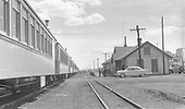 Special D&amp;RGW passenger train of at least 7 or 8 coaches at Chama Depot.  A 1956 Plymouth automobile is parked at depot.<br /> D&amp;RGW  Chama, NM  Taken by Best, Gerald M. - ca 1960