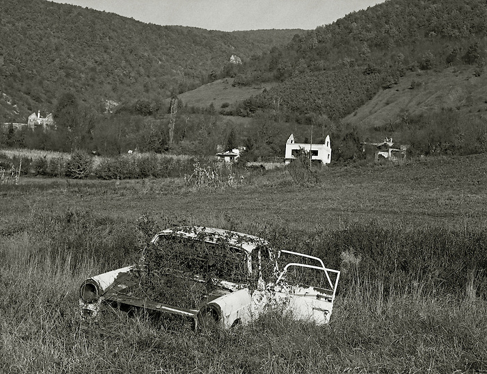An abandoned car in a minefield in NorthWest Bosnia.1997.