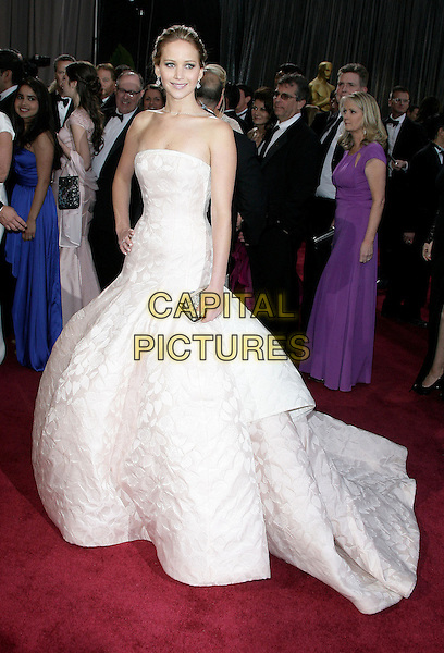 Jennifer Lawrence (wearing Dior Haute Couture).85th Annual Academy Awards held at the Dolby Theatre at Hollywood & Highland Center, Hollywood, California, USA..February 24th, 2013.oscars full length white pale pink strapless dress gown voluminous clutch bag full-tiered skirt hand on hip.CAP/ADM.©AdMedia/Capital Pictures.