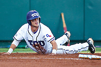 Taylor Featherston (12) sliding home April 27th, 2010; NCAA Baseball action, Baylor University Bears vs TCU Horned Frogs at Lupton Stadium in Fort Worth, Tx;  TCU won 5-4 in extra innings.