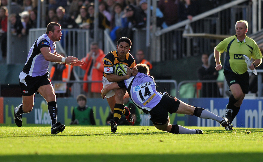 Photo: Tony Oudot/Richard Lane Photography. Exeter Chiefs v London Wasps. LV= Cup. 06/11/2010. .David Lemi of Wasps is challenged by Paul McKenzie of Chiefs.