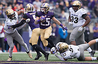 Sean McGrew teamed up with the rest of the Husky running backs to fill in for Myles Gaskin.