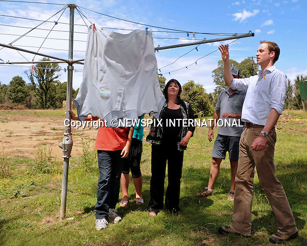 """PRINCE WILLIAM.Prince William visited an educational centre in King Lake West, where he met Colin, Michelle, Darcy and Vam French who lost there home to the fires, the Prince also saw a washing line unchanged from the day of the fire. King Lake West, Shire of Murrindindi, Australia_21/01/2010..Mandatory Credit Photo: ©DIAS-NEWSPIX INTERNATIONAL..**ALL FEES PAYABLE TO: """"NEWSPIX INTERNATIONAL""""**..IMMEDIATE CONFIRMATION OF USAGE REQUIRED:.Newspix International, 31 Chinnery Hill, Bishop's Stortford, ENGLAND CM23 3PS.Tel:+441279 324672  ; Fax: +441279656877.Mobile:  07775681153.e-mail: info@newspixinternational.co.uk"""