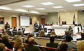 Defense Witness Robert Holmes, Muhammad's friend from Tacoma, Washington testifies during the penalty phase of the trial. Convicted sniper John Allen Muhammad is seated at left, as Prince William Commonwealth Attorney Paul Ebert addresses the court in courtroom 10 at the Virginia Beach Circuit Court in Virginia Beach, Virginia on November 20, 2003.<br /> Credit: Lawrence Jackson - Pool via CNP