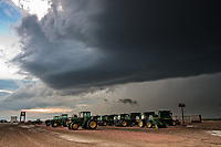 Thunderstorm above John Deere tractors in Scottsbluff, NE, June 9, 2010
