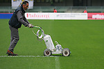 A gardener tracing line in action during the Serie A football match Chievo Verona vs AC Milan at Verona, on November 10, 2013.