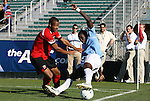 14 November 2010: Maryland's Ethan White (left) and UNC's Jalil Anibaba (right). The University of Maryland Terrapins defeated the University of North Carolina Tar Heels 1-0 at WakeMed Soccer Park in Cary, North Carolina in the ACC Men's Soccer Tournament Championship game.