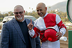 ARCADIA, CA  DECEMBER 28: Jockey Mike Smith holds up one finger to signify his breaking of Jerry Bailey's record for the most Grade 1 races won, after winning the Malibu Stakes (Grade 1) on December 28, 2019 at Santa Anita Park in Arcadia, CA.(Photo by Casey Phillips/Eclipse Sportswire/CSM)