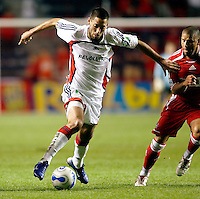 New England Revolution midfielder Clint Dempsey (2) dribbles past Chicago Fire midfielder Chris Armas (14).  The Chicago Fire defeated the New England Revolution 2-1 in the quarterfinals of the U.S. Open Cup at Toyota Park in Bridgeview, IL on August 23, 2006...