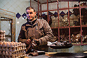 Young man selling live chickens and eggs, Souk, Medina, Marrakech, Morocco.