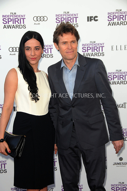 WWW.ACEPIXS.COM . . . . .  ....February 25 2012, LA....Actor Willem Dafoe (R) and wife Giada Colagrande arriving at the 2012 Film Independent Spirit Awards at Santa Monica Pier on February 25, 2012 in Santa Monica, California.....Please byline: PETER WEST - ACE PICTURES.... *** ***..Ace Pictures, Inc:  ..Philip Vaughan (212) 243-8787 or (646) 769 0430..e-mail: info@acepixs.com..web: http://www.acepixs.com