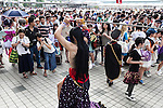 Photographers line up to take pictures of a cosplayer during the ''Comic Market 88 Summer 2015'' exhibition at Tokyo Big Sight on August 14, 2015, Tokyo, Japan. Thousands of manga and anime fans attended the first day of the Comic Market 88 (Comiket) at Tokyo Big Sight. The Comic Market was established in 1975 to allow fans and artists to interact and focuses on manga, anime, gaming and cosplay. The exhibition is held from August 14th to 16th and Comiket organisers expect more than 500,000 visitors to attend. (Photo by Rodrigo Reyes Marin/AFLO)