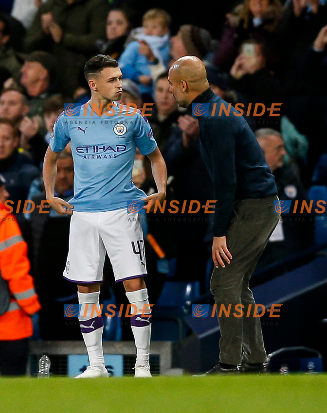 Manchester City Manager Pep Guardiola speaks to Phil Foden of Manchester City as he prepares to come on during the UEFA Champions League Group C match between Manchester City and Dinamo Zagreb at the Etihad Stadium on October 1st 2019 in Manchester, England. (Photo by Daniel Chesterton/phcimages.com)<br /> Foto PHC/Insidefoto <br /> ITALY ONLY