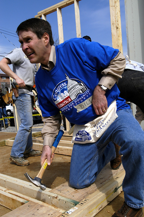 Sen. Bill Frist, R-Tn., helps build a house for the Tomlinson family at 217 54th St. NE, as a part of Congress Building America, a partnership bewteen Habitat for Humanity and Congress.