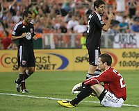 Troy Perkins #23 of D.C. United sits dejectedly after the first Houston goal during an MLS match against the Houston Dynamo at RFK Stadium in Washington D.C. on September  25 2010. Houston won 3-1.