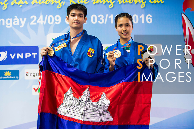 POV Sokha and LY Boramy of Cambodia celebrate after winning the Vovinam Mixed Events Self-defense for Women on Day Eight of the 5th Asian Beach Games 2016 at Bien Dong Park on 01 October 2016, in Danang, Vietnam. Photo by Marcio Machado / Power Sport Images