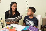 10 year old boy at home with mother, doing homework, talking over problem
