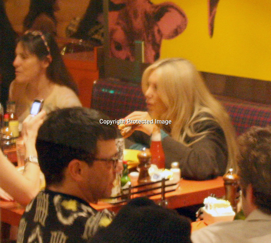 6-24-09  Exclusive..11pm Stephanie Pratt chowing down on a hamburger with a friend at Swingers Restaurant in west Hollywood California. NO more bulimia...  AbilityFilms@yahoo.com.805-427-3519.www.AbilityFilms.com.