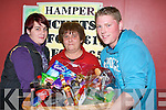 ..FIRST: Magie O'Rourke who was the first winner of the St John's Bazaar Hamper in the KDYS on Friday eveing. L-r: Lorraine O'Rourke, Magie O'Rourke (Ballyduff) and Daragh Creagh (Tralee)..........   Copyright Kerry's Eye 2008
