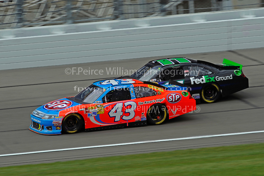 Aric Almirola (#43) and Denny Hamlin, (#11) FedEx Ground Camry.