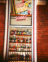 A window of a store displaying sodas for sale in Nashville, Tennessee.