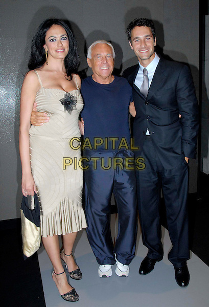 MARIA GRAZIA CUCINOTTA, GIORGIO ARMANI & RAUL BOVA.Armani's Spring-Summer 2007 men's collection, during Milan's fashion shows, Milan, Italy..June 28th, 2006 .Ref: OME.full length suit beige dress blue tee shirt tracksuit bottoms.www.capitalpictures.com.sales@capitalpictures.com.© Capital Pictures.