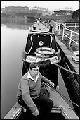 Colin MacDonald, Chair of the Railway Lands Community Development Group, on his boat at Goodsway Moorings on the edge of the King's Cross development site - his home until the British Waterways Board withdrew residential mooring rights.  He is now living temporarily in a nearby pub (itself scheduled for demolition if the LRC plans go through); London 1989.