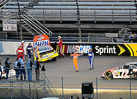 May 1, 2009; Richmond, VA, USA; NASCAR Nationwide Series driver Eric McClure (4) expresses his displeasure after a crash during the Lipton Tea 250 at the Richmond International Raceway. Mandatory Credit: Mark J. Rebilas-