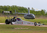 Apr 27, 2014; Baytown, TX, USA; The car of NHRA top fuel driver Antron Brown is towed past a helicopter during the Spring Nationals at Royal Purple Raceway. Mandatory Credit: Mark J. Rebilas-USA TODAY Sports
