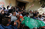Mourners carry the body of Palestinian Mohammed Alian, 20, who died of wounds he sustained during clashes with Israeli troops in a tent city protest where Palestinians demand the right to return to their homeland and against U.S. embassy move to Jerusalem at the Israel-Gaza border, during his funeral in Nusseirat refugee camp in the Gaza Strip on May 19, 2018. Photo by Ashraf Amra