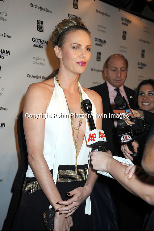 Charlize Theron in Gucci dress attends IFP'S 21st Annual Gotham Independent Film Awards on November 28, 2011 at Cipriani Wall Street in New York City.