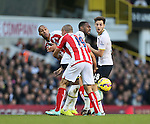 Tottenham's Danny Rose gets injured in this tackle with Stoke's Steven Nzonzi and Jonathan Walters<br /> <br /> - Barclays Premier League - Tottenham Hotspur vs Stoke City- White Hart Lane - London - England - 9th November 2014  - Picture David Klein/Sportimage