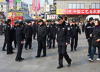 Dozens of chinese police officers forbiding protesters to gather in the center of Beijing, at the Mac Donald of Wangfujing avenue where a rally was planned today. Feb. 27 2011