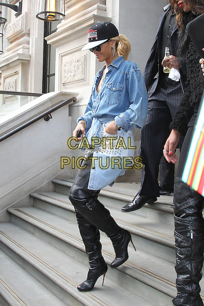 Rihanna (Robyn Rihanna Fenty).Rihanna leaving her hotel, London, England..February 29th, 2012.full length black boots leather thigh high otk denim jean shirt shorts white baseball cap hat black sunglasses shades side profile ponytail  .CAP/HIL.©John Hillcoat/Capital Pictures .
