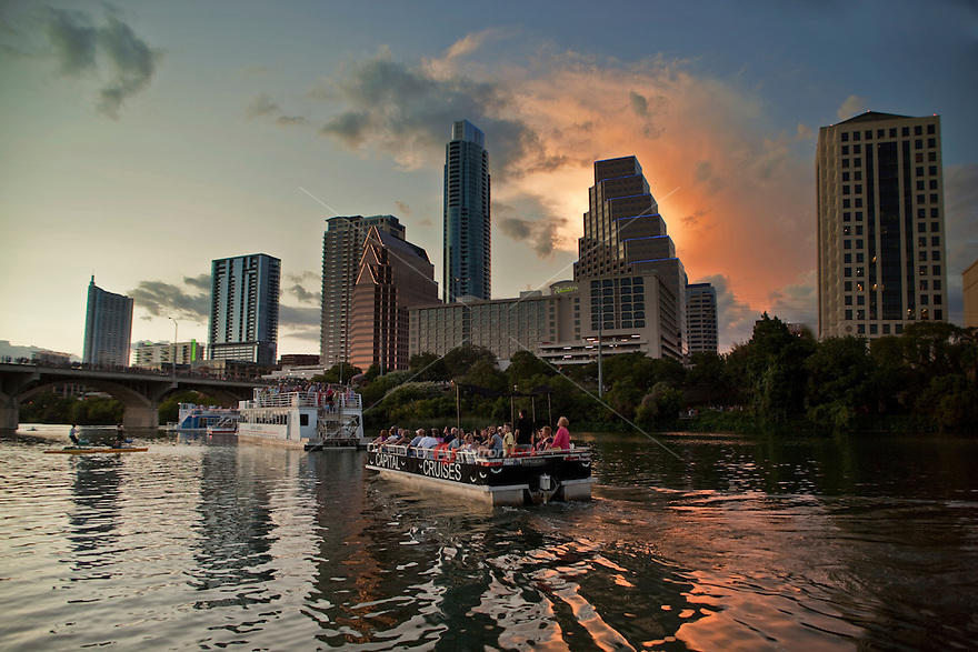 Austin bat-watching cruise ships and boats gather to watch the nightly bat departure from the Congress Ave. Bridge