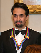 Lin-Manuel Miranda, one of the special honorees for Groundbreaking Work on Hamilton, as he poses with the recipients of the 41st Annual Kennedy Center Honors pose for a group photo following a dinner hosted by United States Deputy Secretary of State John J. Sullivan in their honor at the US Department of State in Washington, D.C. on Saturday, December 1, 2018.  The 2018 honorees are: singer and actress Cher; composer and pianist Philip Glass; Country music entertainer Reba McEntire; and jazz saxophonist and composer Wayne Shorter. This year, the co-creators of Hamilton,­ writer and actor Lin-Manuel Miranda; director Thomas Kail; choreographer Andy Blankenbuehler; and music director Alex Lacamoire will receive a unique Kennedy Center Honors as trailblazing creators of a transformative work that defies category.<br /> Credit: Ron Sachs / Pool via CNP